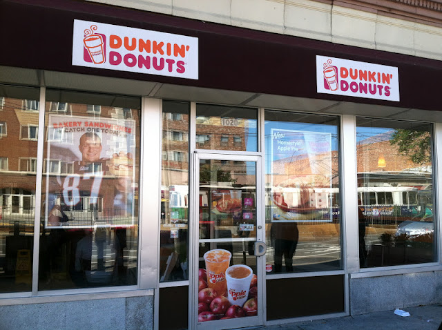 Dunkin' Donuts stores are as iconic in Boston as the New England Patriots and the T, which are all included in this photo taken during my many hours of participant observation studying Dunkin' Donuts coffee.
