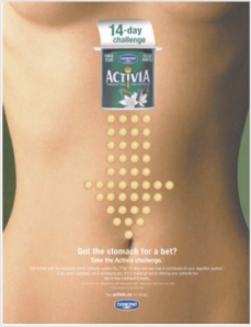 This sexualized image appeared in a Canadian Activia campaign. Like other advertisements, it features a woman's flat abdomen. It also exposes the lower curve of her breasts.